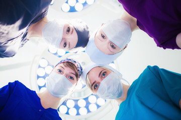 health care. health. The bottom view of four surgeons in the operation. The concept of organ transplantation. Teamwork to save lives belov shot