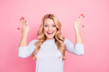 Wall Mural - Portrait of funny comic exited girl with modern hairdo gesturing with arms looking at camera full of happiness isolated on pink background
