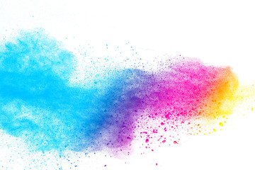 Multi color powder explosion on white background. Launched colorful dust particles splashing.