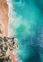 Fototapete - Drone shot of tropical sandy beach and ocean with clear turquoise water.
