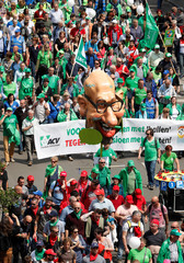 A giant face depicting Belgian Prime Minister Charles Michel is seen while Belgian workers and employees take part in a protest against planned pension reforms in central Brussels