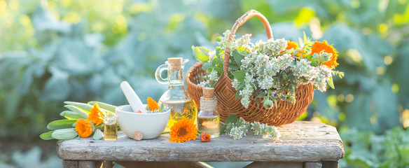 Spa composition with Fresh herbs, calendula and different types of oils. Shallow depth of field Fotoväggar