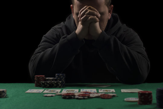 Poker table setup. High resolution image for gambling industry containning pokers chips, cards, green surface and person.