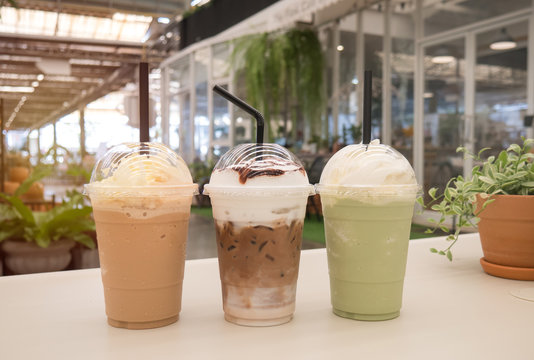 Chocolate,green tea frappe and coffee frappuccino on white table