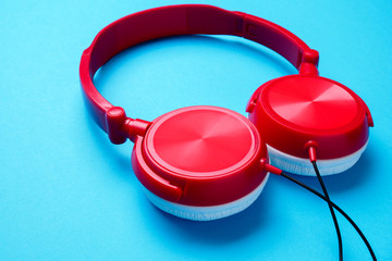 Photo of red with white headphones for music from above