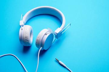 Photo of white headphones with cord
