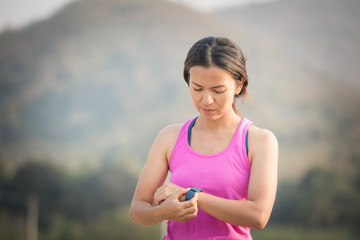 Woman checking fitness and health tracking wearable device