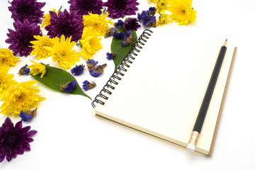 top view book  and pencil for note isolated on white background decorate by chrysanthemum, yellow and purple flower, green leave. Desk office concept with copy space