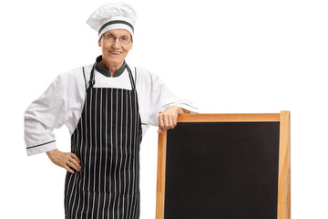 Elderly chef with a blankboard