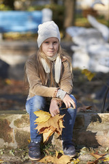 Girl in autumn yellow leaves