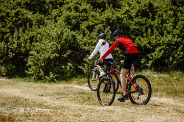 Healthy lifestyle - people riding bicycles