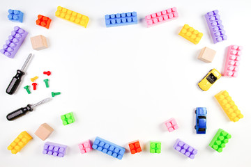 Kids toys frame on white background. Top view. Flat lay.