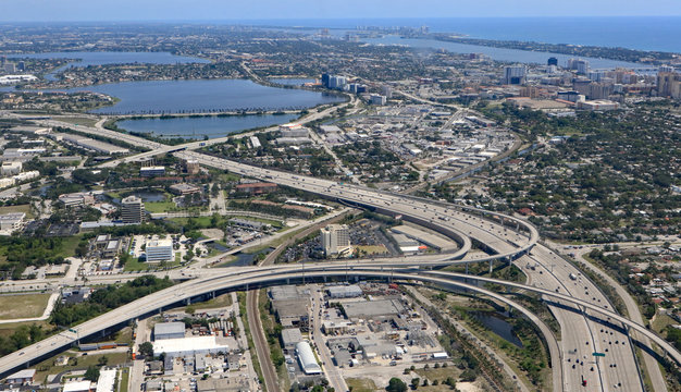 Aerial view of downtown West Palm Beach, Florida, with the I-95 expressway, and interchange, a key roadway to South Florida.