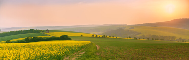 Old windmill at sunset. Spring landscape. Moravia fields panorama