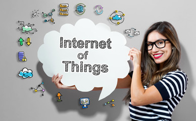 Internet of Things text with young woman holding a speech bubble