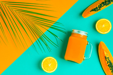 Smoothies / cocktail / juice on a bright pastel background.