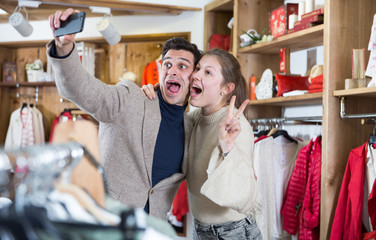 Couple is satisfied shopping and taking selfie