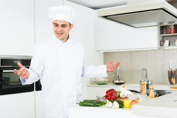 Professional man chef searching ingredients, preparing vegetables