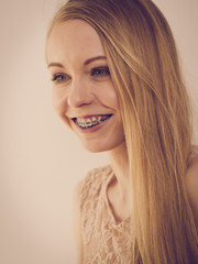 Woman showing her teeth with braces