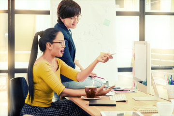 Asian woman management director and Asian woman project leader in casual suit have discussion in modern office. Project group and Office concept.