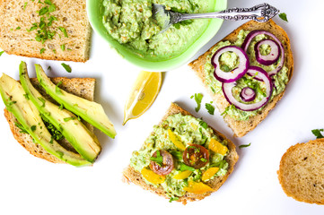 Healthy sandwiches with avocado and vegetables