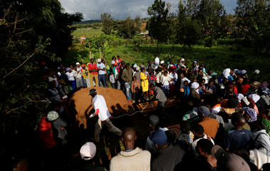 Mourners prepare to bury their relatives killed when a dam burst its walls, overrunning nearby homes, in Solai town near Nakuru