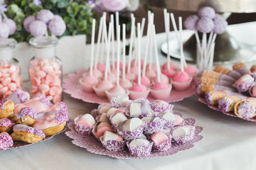 Dessert table for any holiday at wooden background