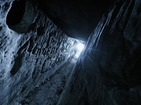 ansient dark stone cave whith letters inside view