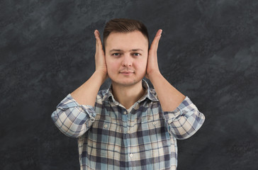 Confused man puts his hands on head