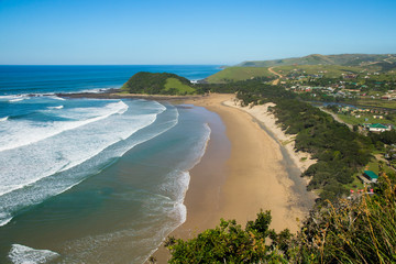 Beach of Coffee Bay on the Wild Coast in Eastern Cape, South Africa, as seen from the top of a cliff