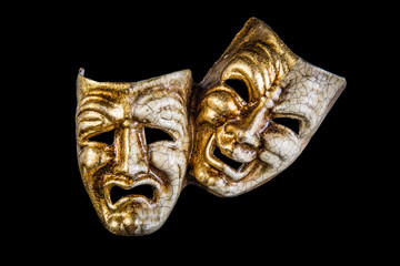 theatrical mask smile and sadness on a black background