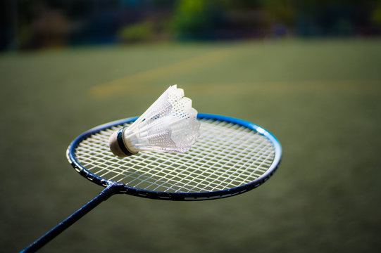 Racket and shuttlecock for playing badminton on the football field
