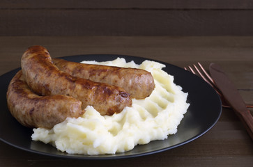 English sausages with mashed potatoes and gravy.