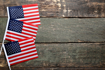 American flags on wooden table