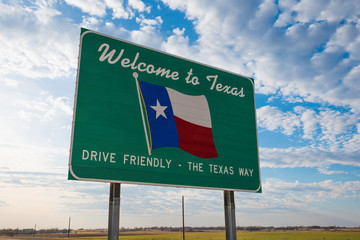 Printed roller blinds Texas Welcome to Texas road sign in front of cloudy sky