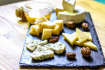 Cheese plate served nuts