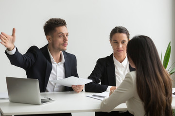 Male HR manager pointing at door, asking female job candidate to leave, colleagues not satisfied with recruitment process and applicant. Concept of bad interview, stubbornness, unsuccessful employment