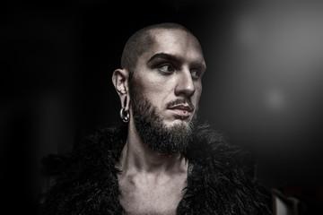 man with piercing in ears