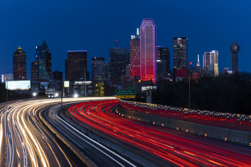 Aluminium Prints Texas MARCH 5, 2018, DALLAS SKYLINE TEXAS, and Tom Landry Freeway, with streaked lights on Interstate 30 at night