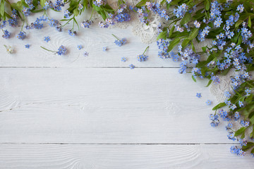 Forget-me-nots flowers on a wooden background