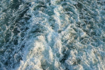 Sea water ship trail with foamy wave.