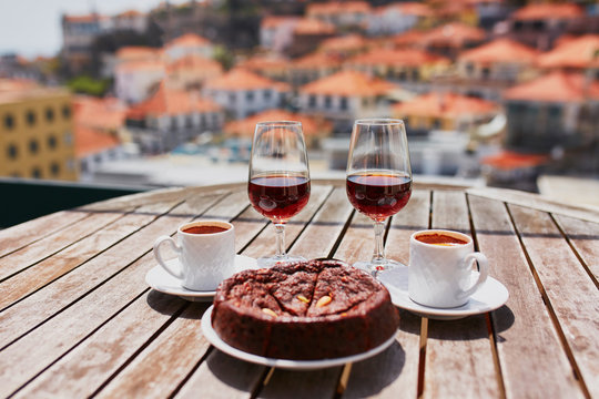 Madeira wine, coffee and hohey cake, View to Funchal, Portugal