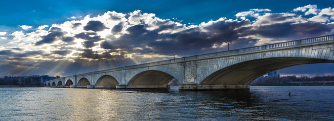 MARCH 25, 2018 - WASHINGTON D.C. - Memorial Bridge at dusk spans Potomac River at sunset