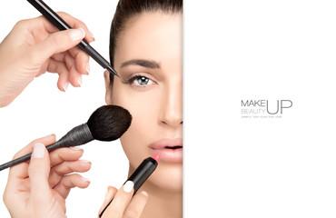 Beautiful model girl with makeup brushes. Makeup concept