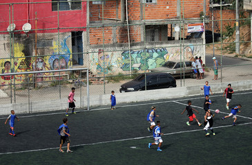Amateur young soccer players attend a training session on a field on the outskirts of Sao Paulo