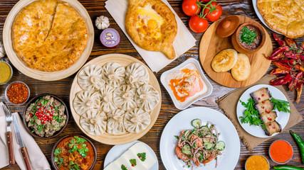 Georgian cuisine foodset from khachapuri, khinkali, pkhali, dolma, satsivi top view Fototapete