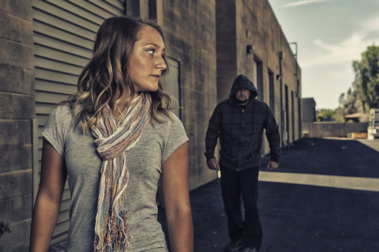Girl who knows self defense sees a man walking behind her.