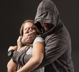 Girl is frightened as she's being grabbed by a stranger.