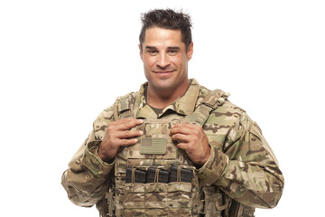 Smiling soldier against white background