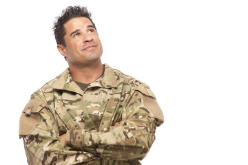 Army soldier smiling and looking up